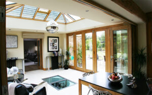 Oak Orangery with Bi-fold folding sliding doors in Surrey
